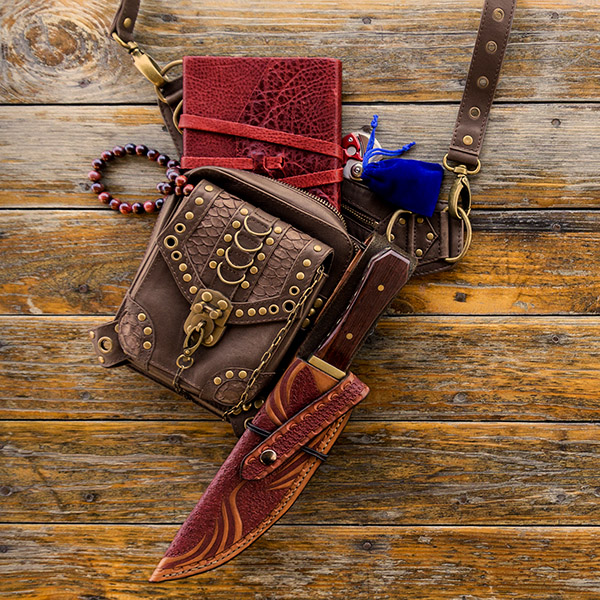 Sophia's bag with bowie knife, beads, and velvet pouch.